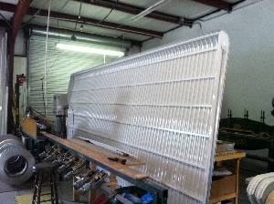 large clamshell aluminum awning
